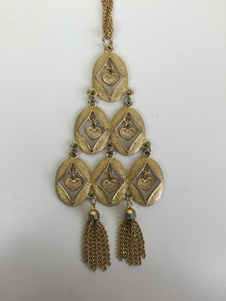 Image of large gold articulated tassel pendant necklace 60s