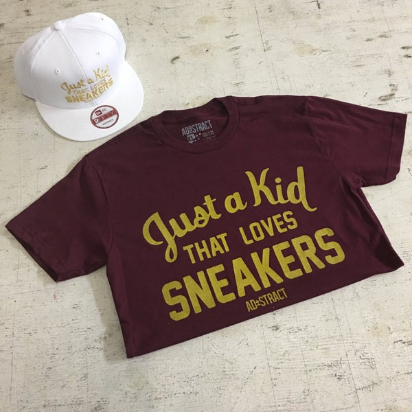 "Image of JUST A KID THAT LOVES SNEAKERS ""BURG/GOLD"" T-SHIRT"