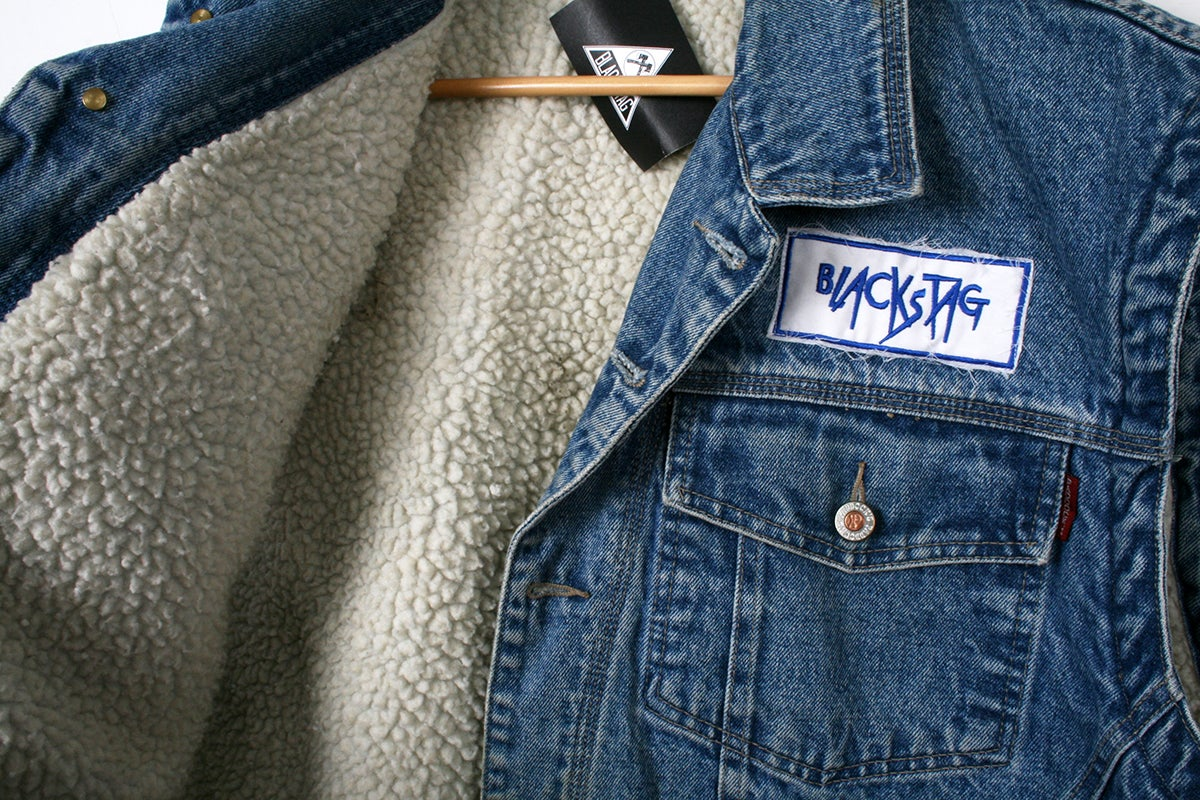 Image of 1980's denim sherpa sleeveless work jacket.