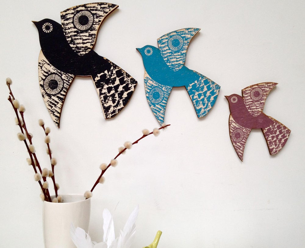 Image of A trio of hand printed wooden birds for your walls.