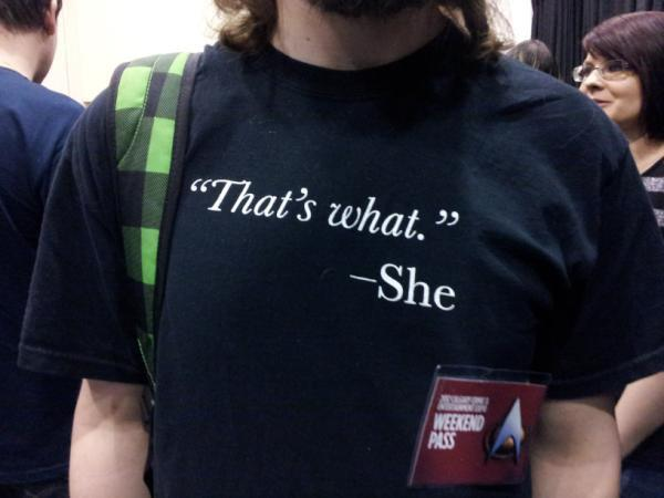 "Image of The original ""That's what.""—She men's tee and ladies' black tank"
