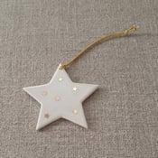 Image of Étoile à suspendre étoiles or