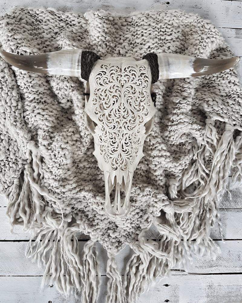 Image of hand carved skull indah