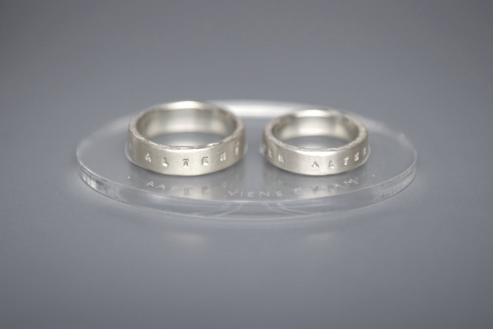 Image of silver wedding rings with Latin inscriptions