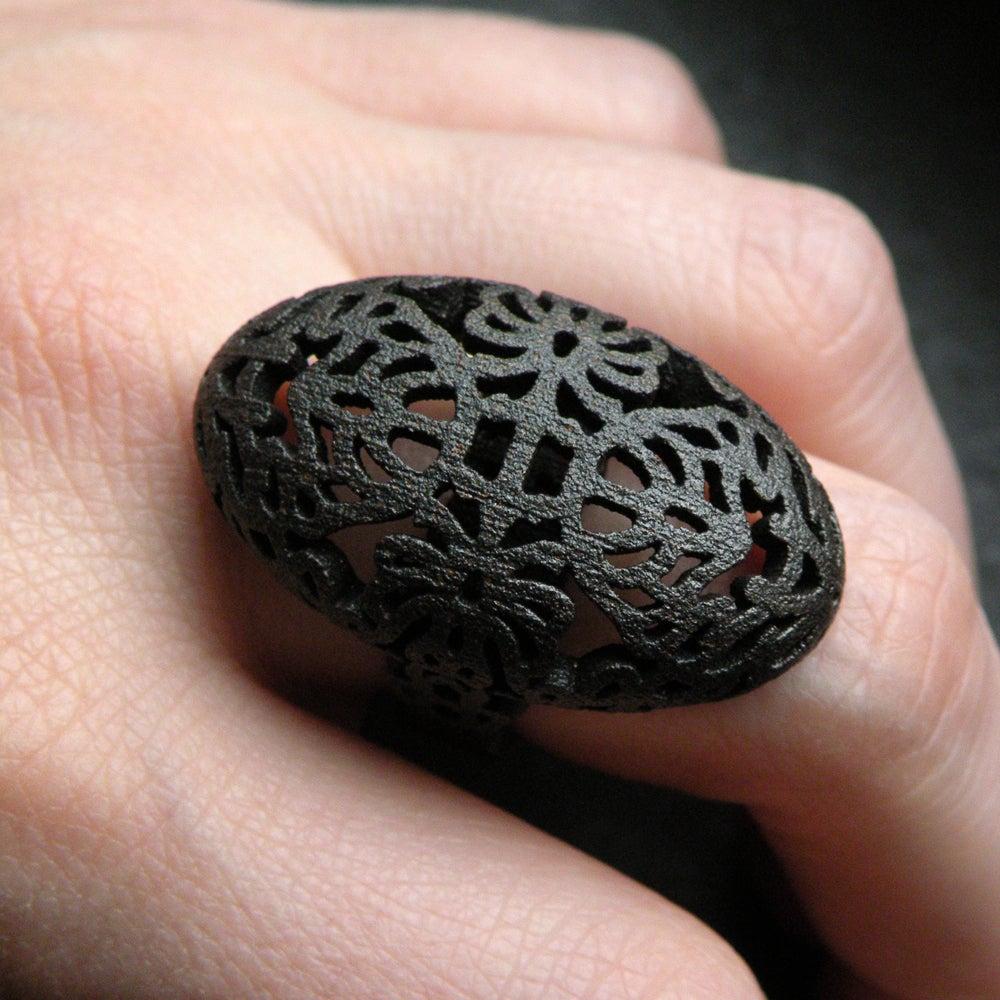 Image of 3D printed rings gold-plated steel/matte black steel