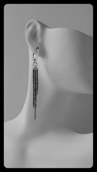 Image of triple spike earrings