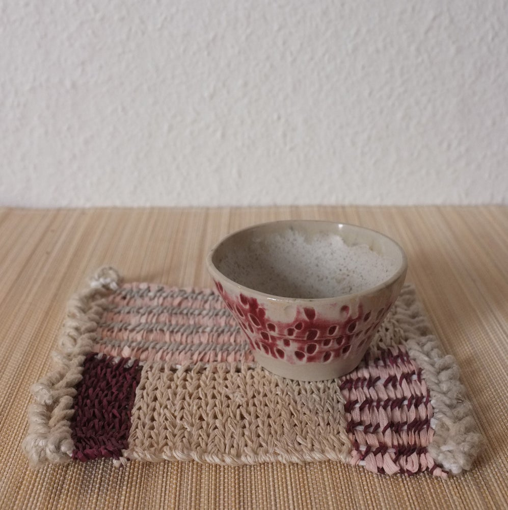 Image of Handmade ceramic olive bowl and woven rectangle mat