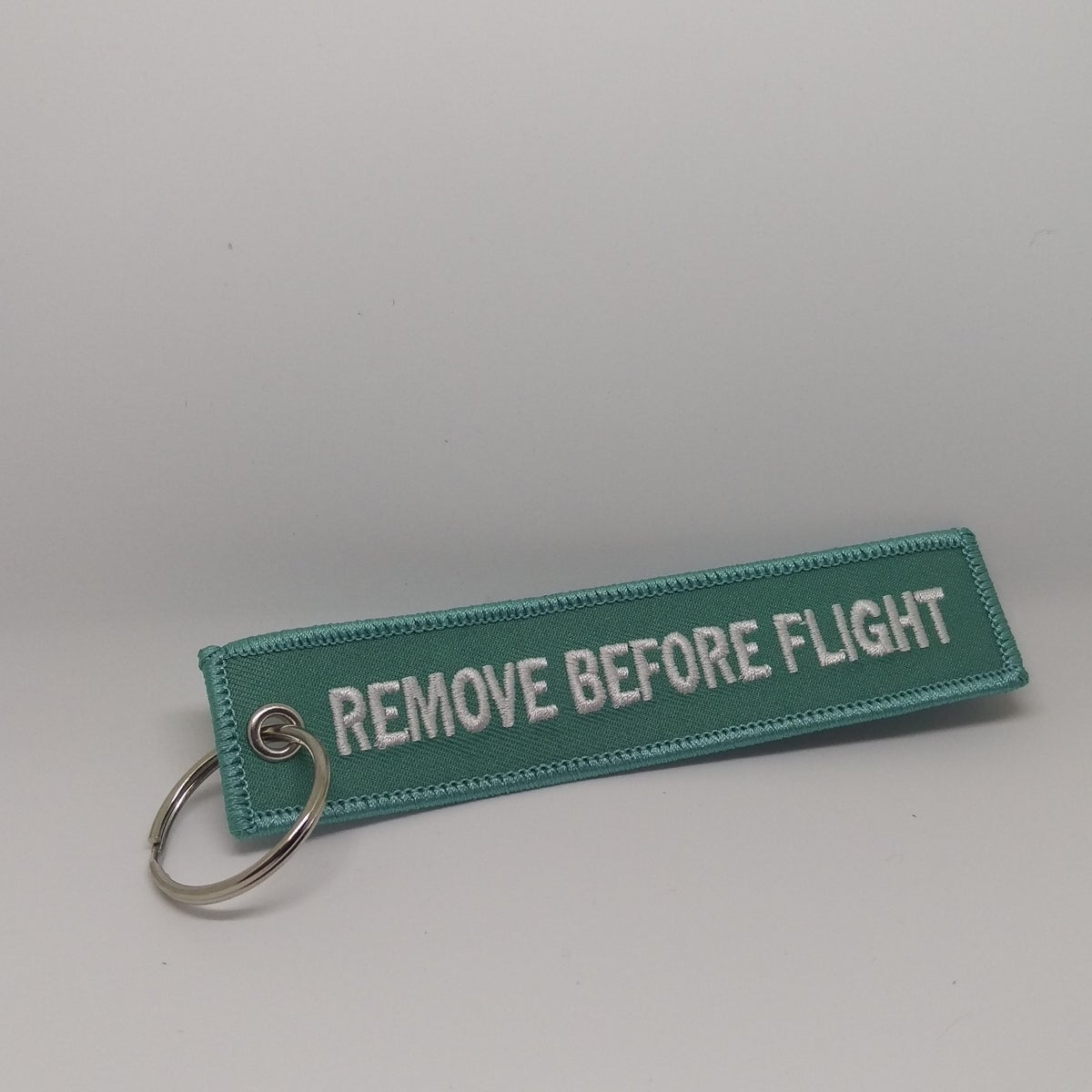Image of Teal - Remove Before Flight Tag