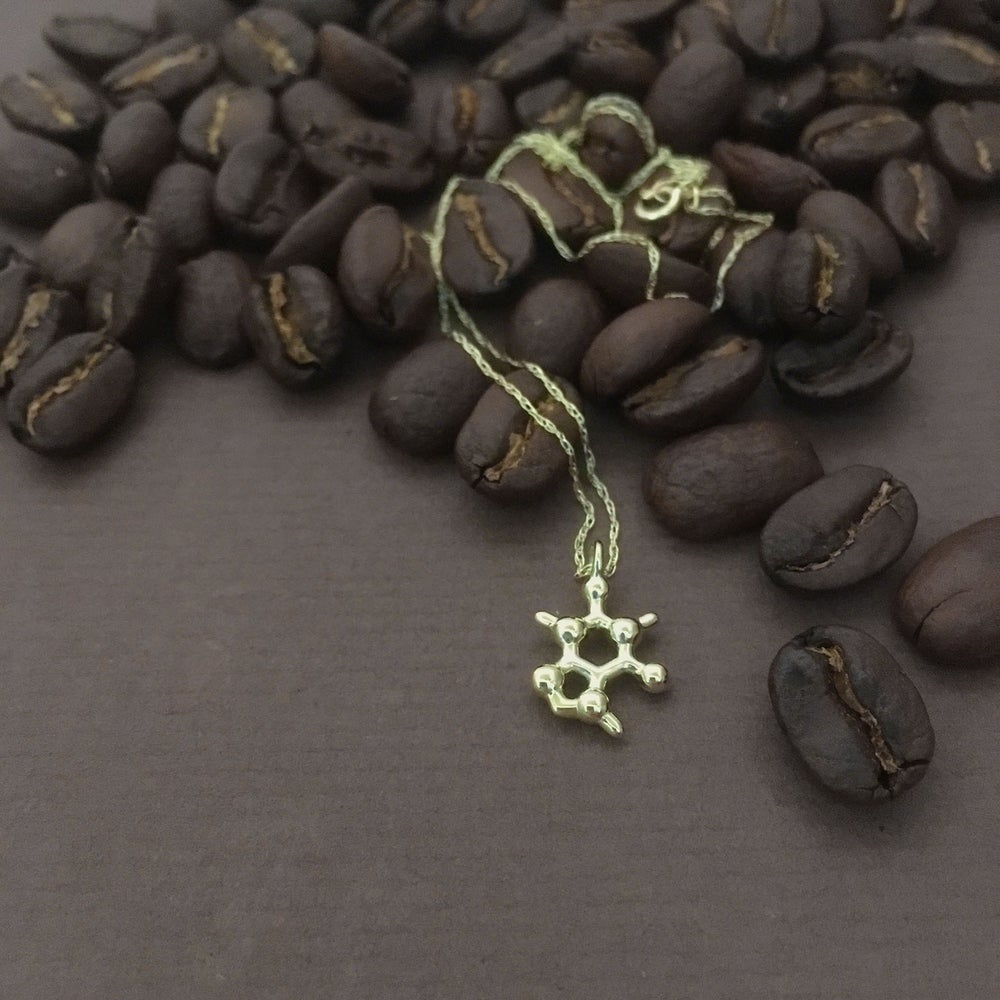 Image of tiny caffeine necklace