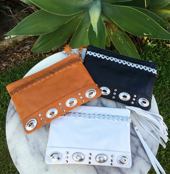 Image of Concho leather clutch