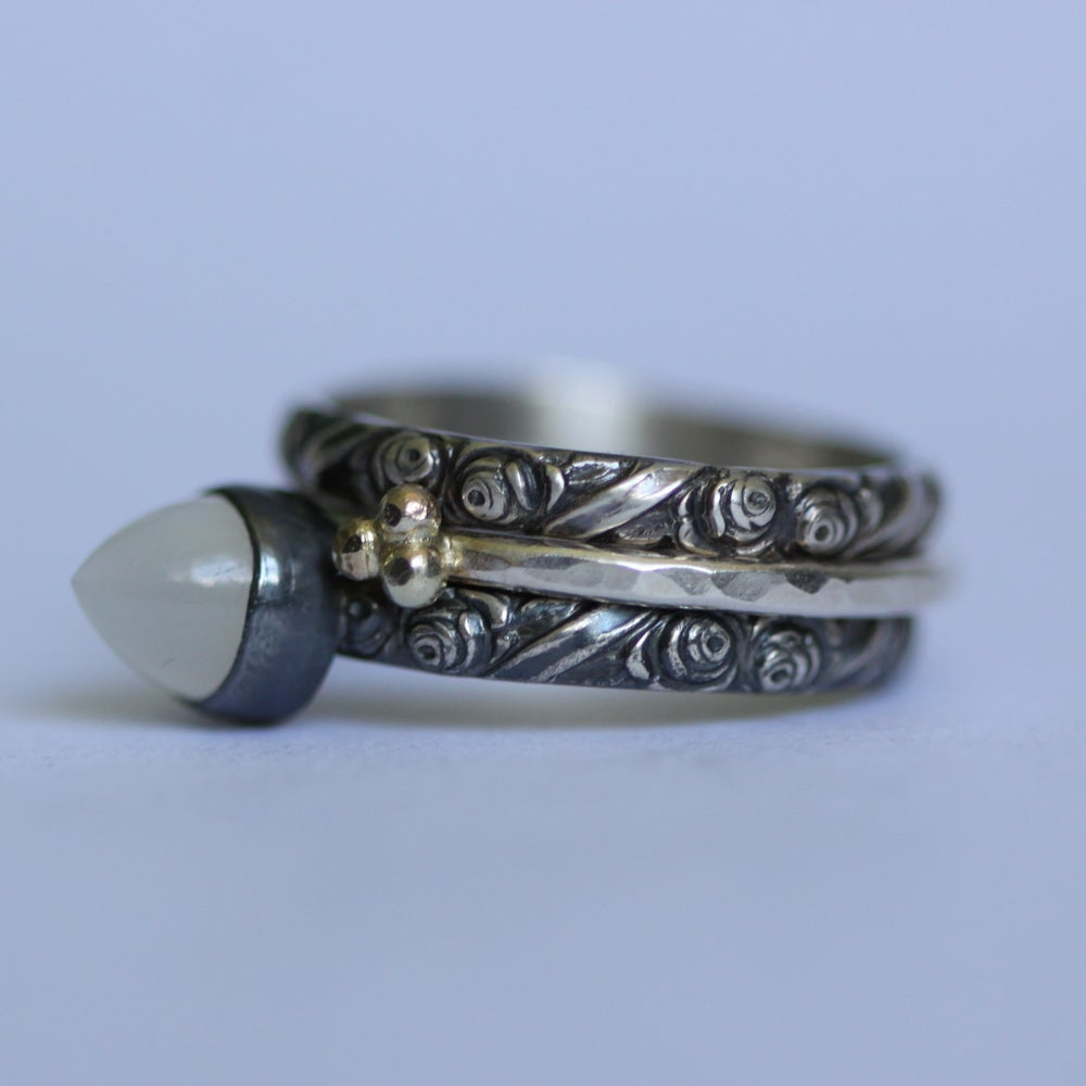 Image of Silver ring with moonstone bullet