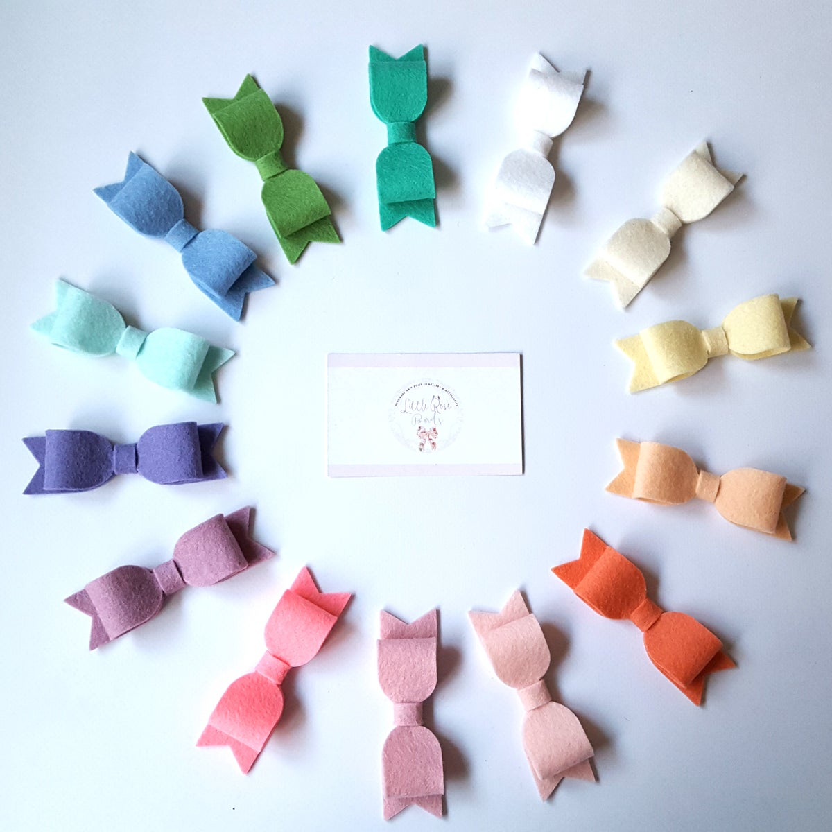 "Image of CHOOSE YOUR COLOUR - Medium (3.5"") Felt Bows on Clips or Headbands"