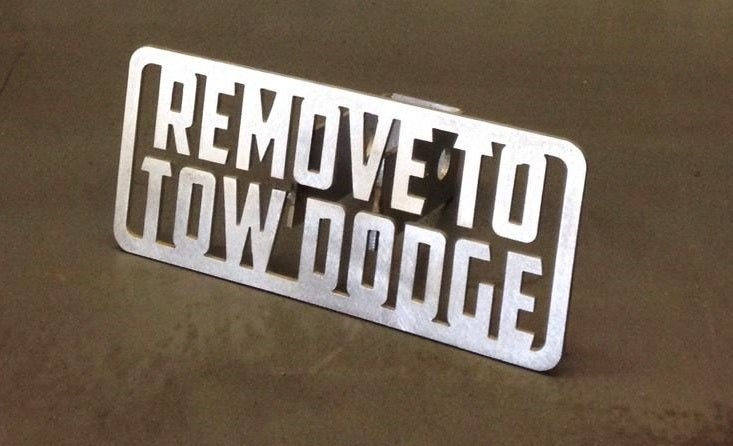 Image of Remove To Tow Dodge Hitch Cover