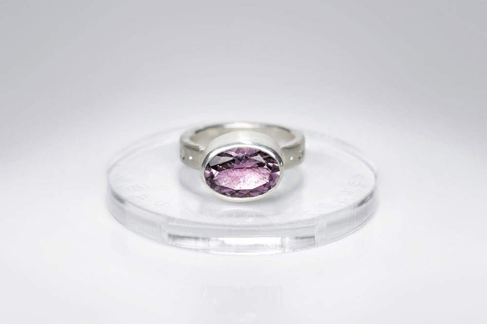 Image of silver ring with amethyst and inscription in Latin