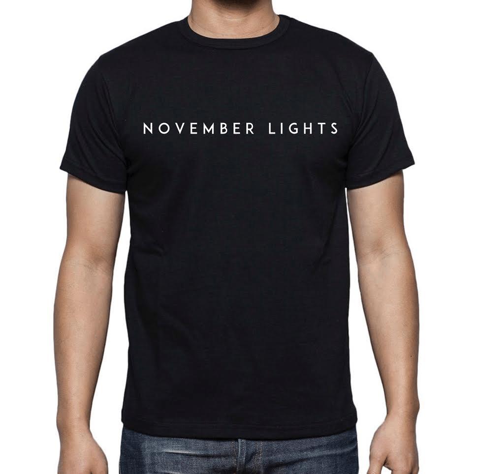 Image of Black November Lights chest design tee.