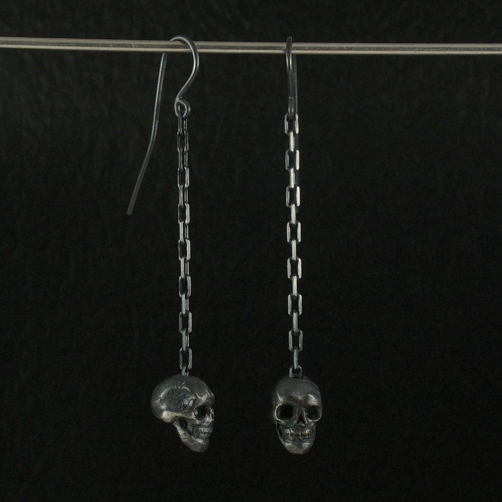 Image of Hanging Skulls Earrings