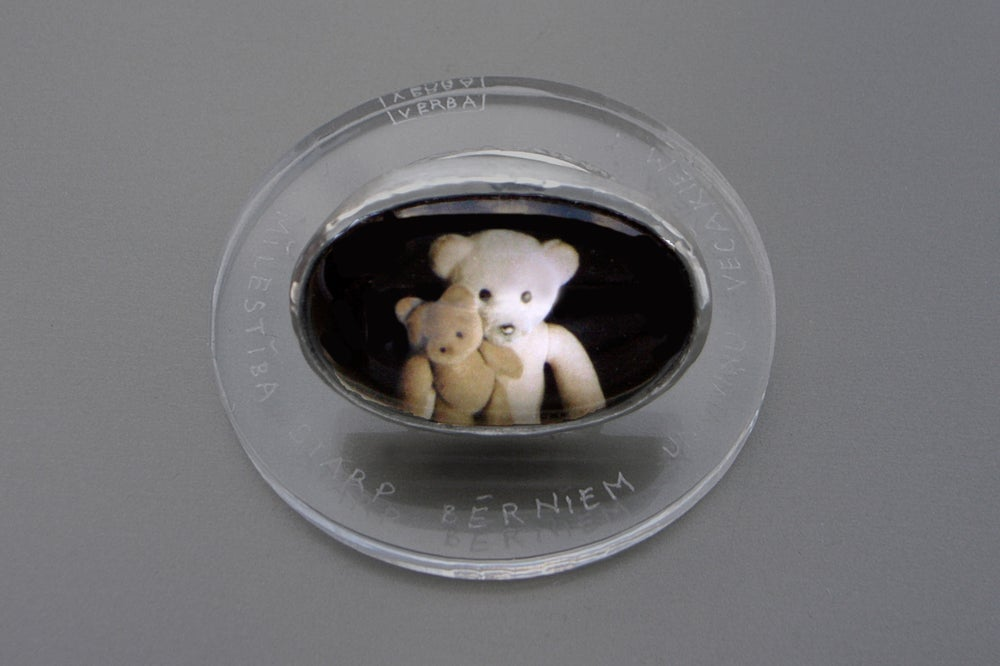 Image of teddy-bear's silver ring with photo and rock crystal CARITAS INTER NATOS ET PARENTES