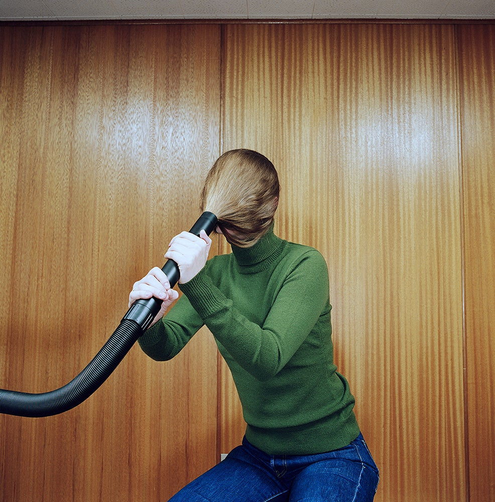 Image of Woman with Hair in Vacuum