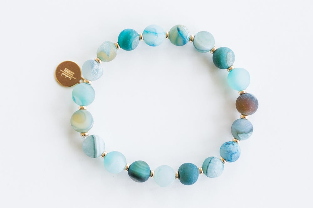 Image of jetsetter ME blue agate frosted