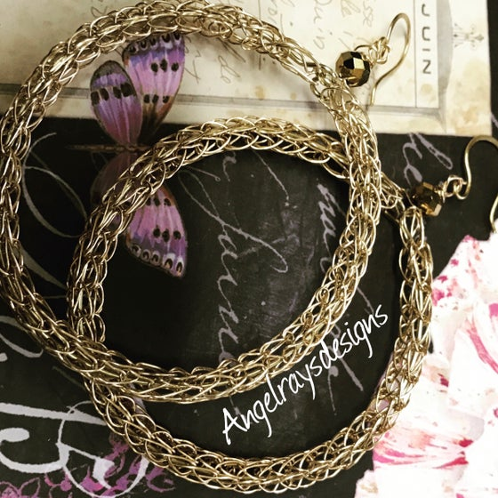 Image of  Viking knit dangle hoops