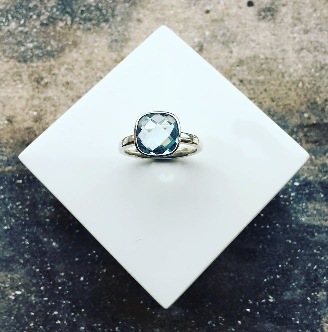 Image of Silver Ring set with a 10mm Cushion Cut Blue Topaz