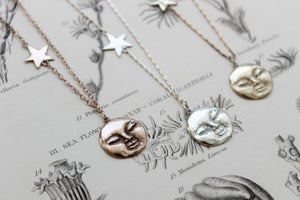 Image of full moon and star necklace