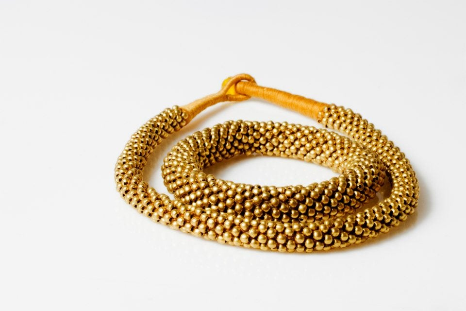 Image of gold or silver necklace +bracelet