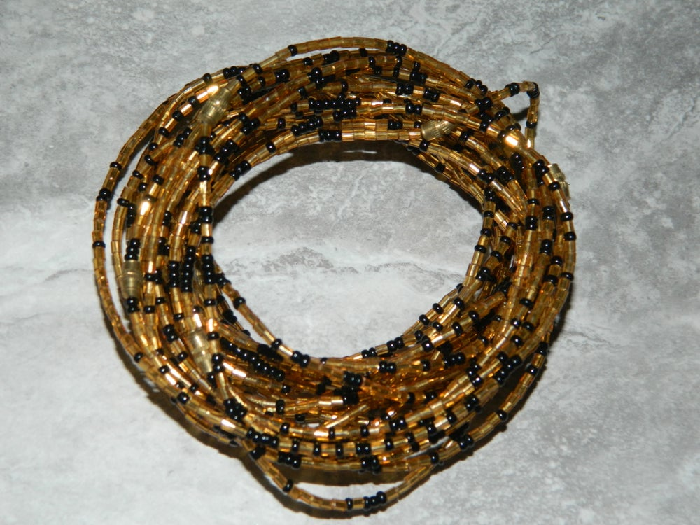 Image of Gold and black glass bead