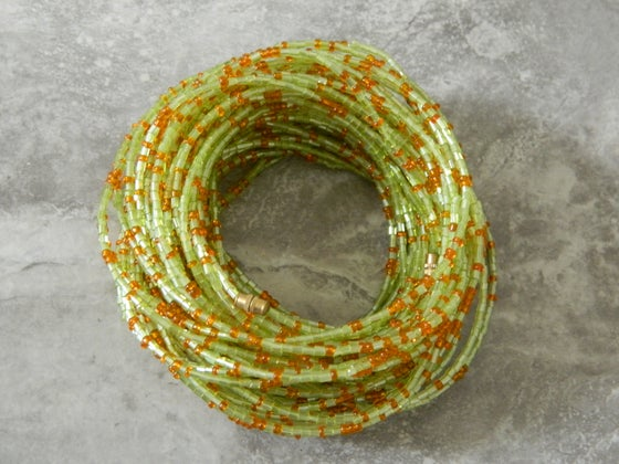 Image of Mint and orange glass bead