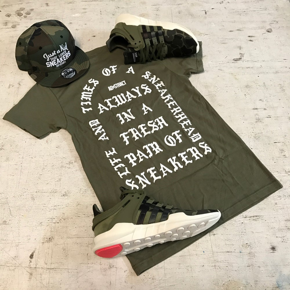 "Image of I AM A SNEAKERHEAD ""OLIVE W/ WHITE OR ORANGE PRINT"" T-SHIRT"