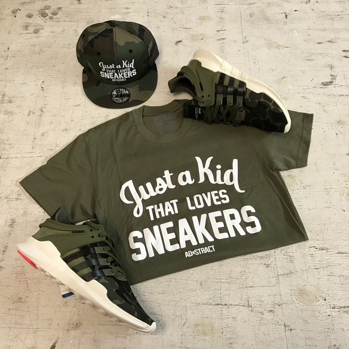 "Image of JUST A KID THAT LOVES SNEAKERS ""OLIVE"" T-SHIRT"