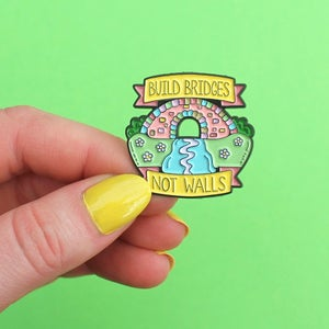 Image of 'Build Bridges Not Walls' enamel pin, rainbow, bridge - lapel pin