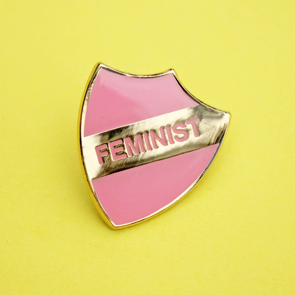 Image of FEMINIST - enamel pin, shield, pink with gold plating, merit style badge
