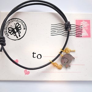 Image of Elephant ,pineapple and palmtree adjustable black leather cord