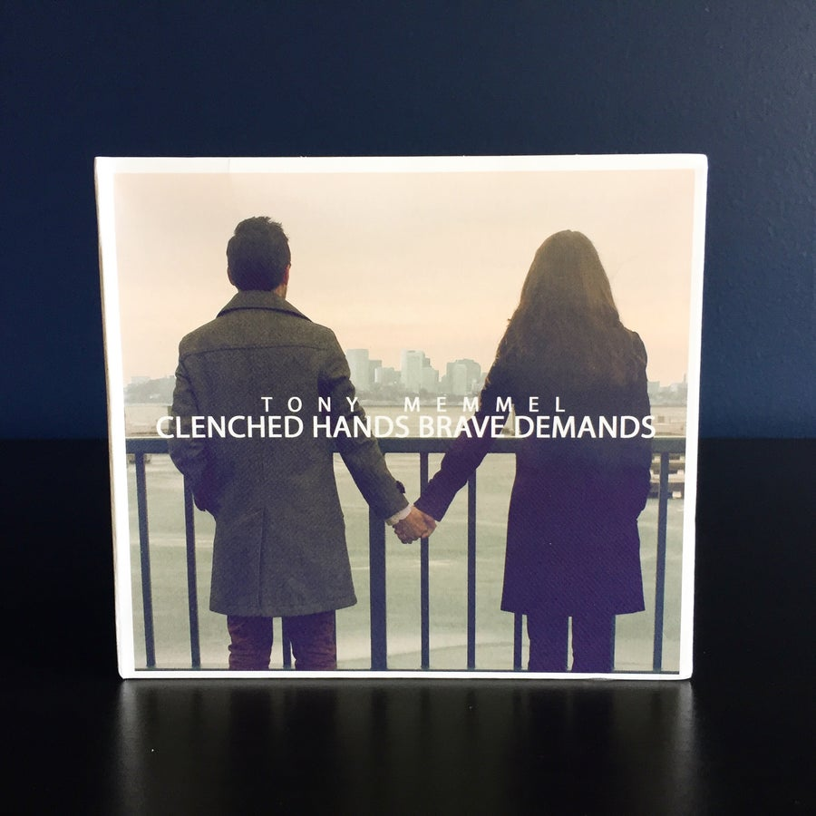 Image of Clenched Hands Brave Demands