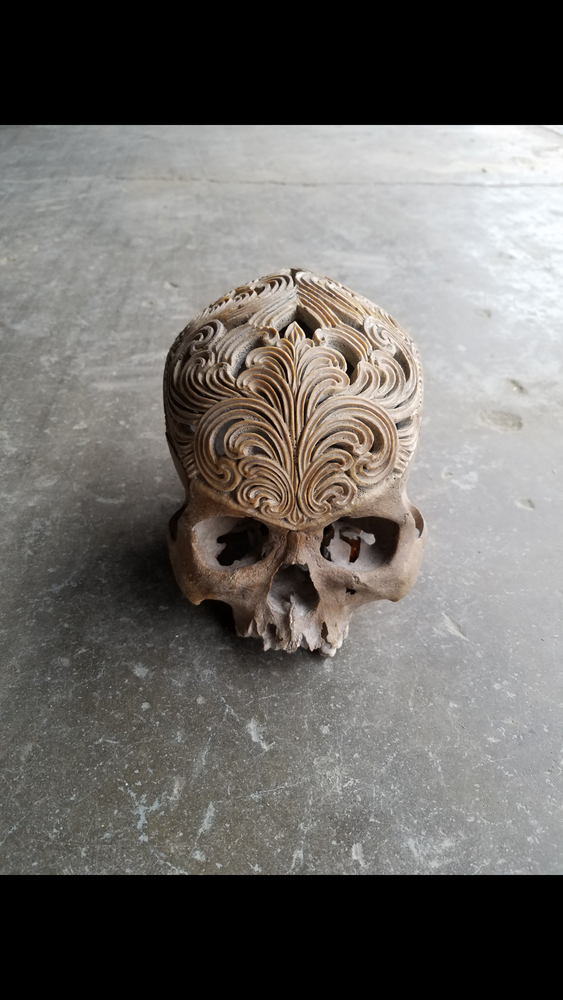Image of Carved human skull ornate