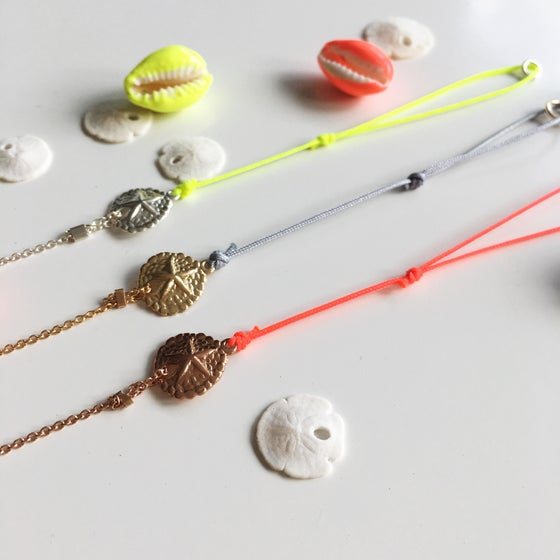 Image of Sand Dollar two-colored bracelet