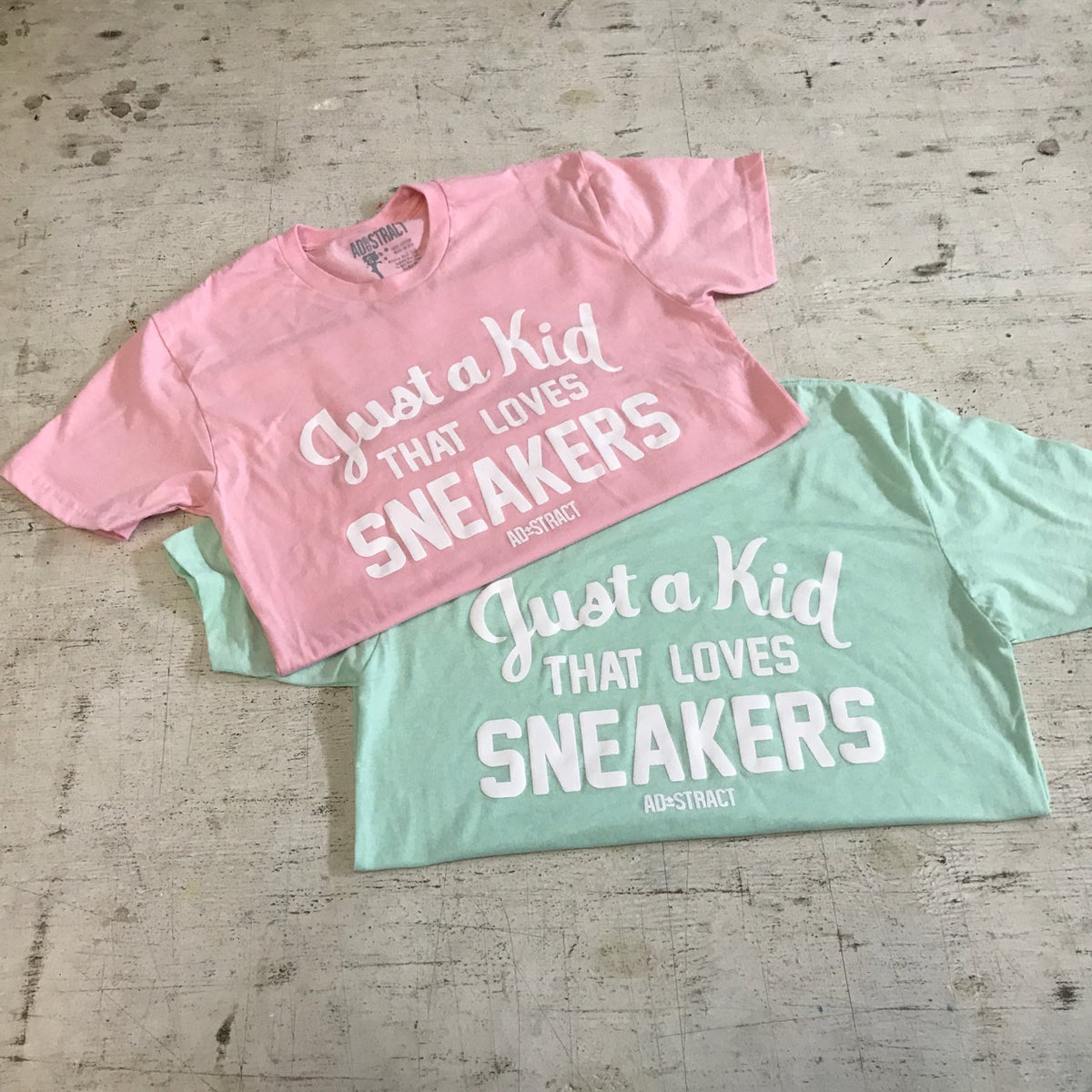 "Image of JUST A KID THAT LOVES SNEAKERS ""PINK, BLUE TINT, TAN, OR MINT"" T-SHIRT"