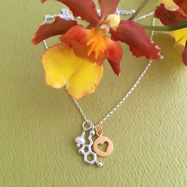 Image of tiny serotonin heart necklace