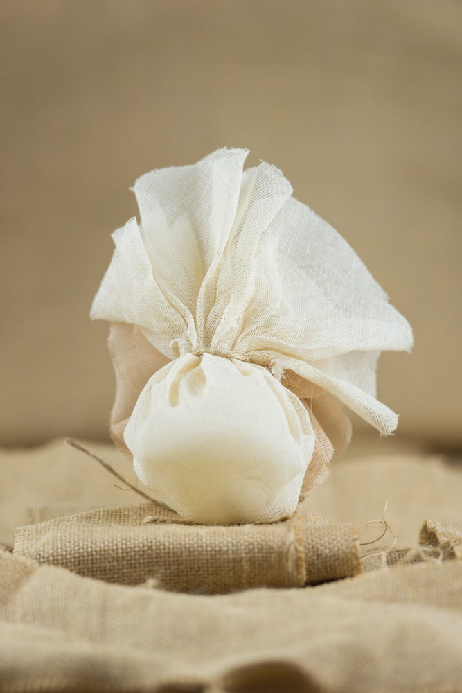 Image of Cream burlap pouch with flower - bomboniere/wedding favours