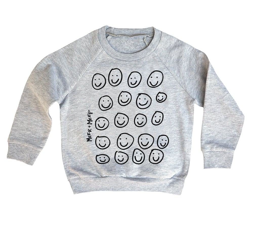 Image of A WORLD FILLED WITH SMILES SWEATSHIRT