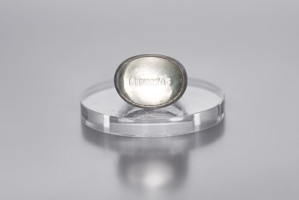 Image of silver ring with rock crystal and inscription in Latin