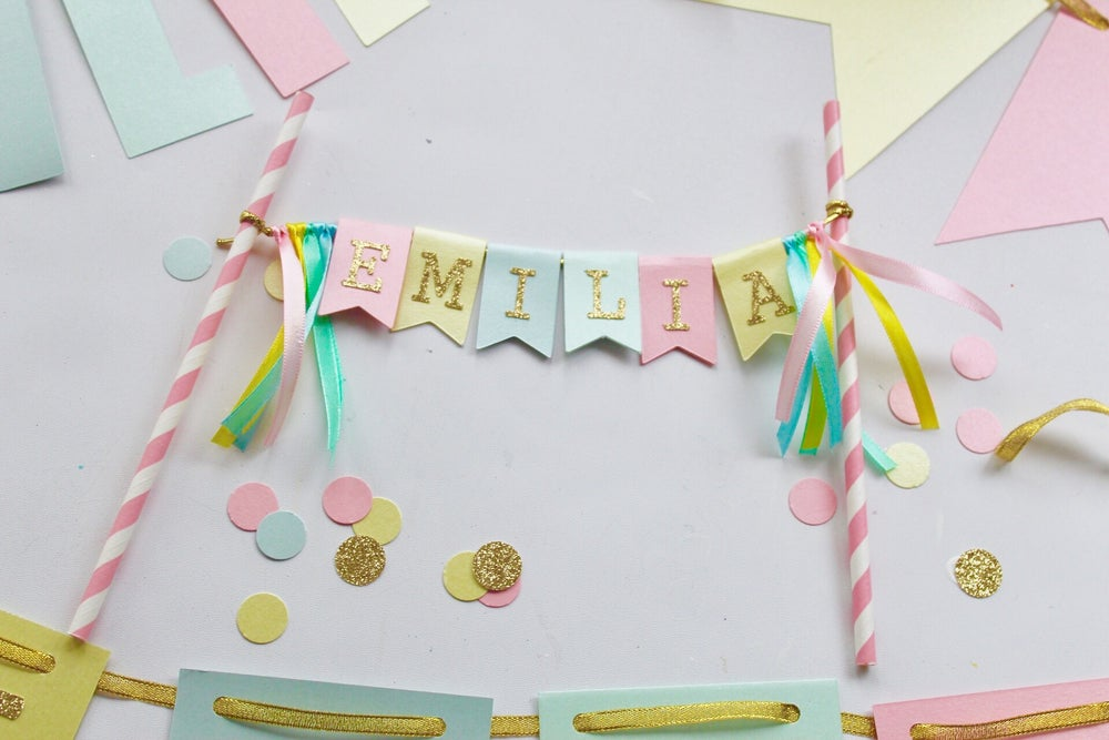Image of Personalised ribbon and bunting flag cake topper