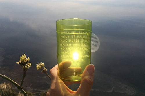 """Image of VERBA handmade green glass with poetry in Latin from the """"Carmina Burana"""" manuscript"""