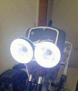 Image of Honda Ruckus Floating Headlight Bracket