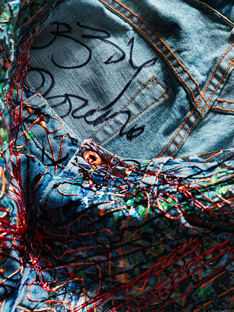 Image of Ozzy Osbourne's Jeans for Refugees
