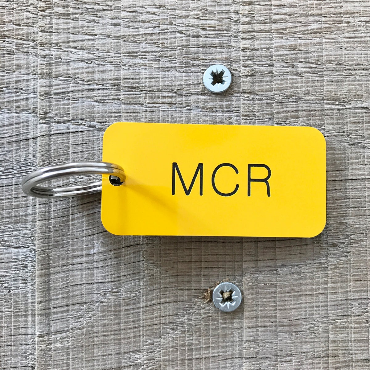 Image of Manchester MCR locker keyring in yellow + black