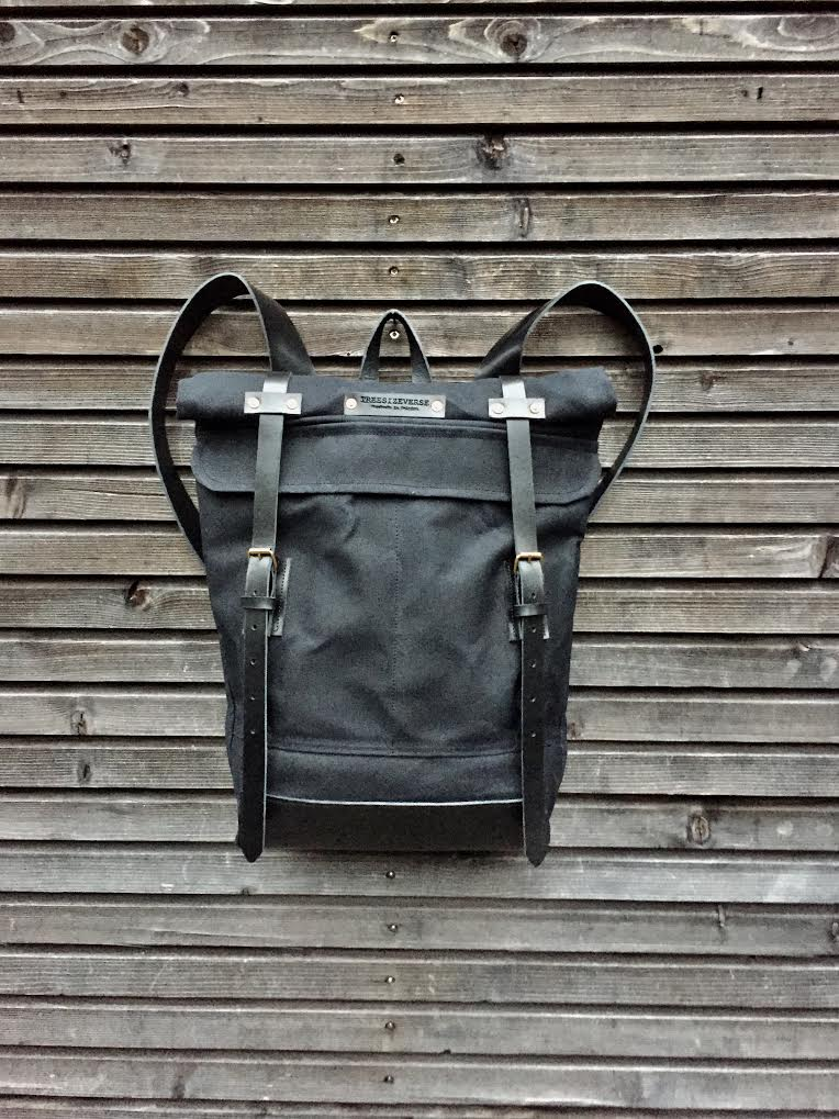 Image of Waxed canvas backpack with roll up top and leather shoulder straps COLLECTION UNISEX