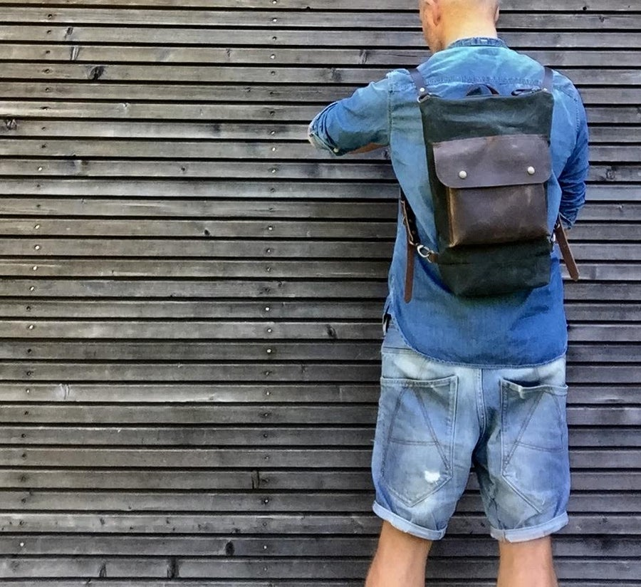 Image of Day pack in waxed canvas with leather outside pocket and zipper closing