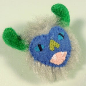 Image of Fuzzy monster pin - grey, periwinkle, green